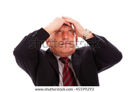 businessman with his hands in his head (isolated on white) - stock photo