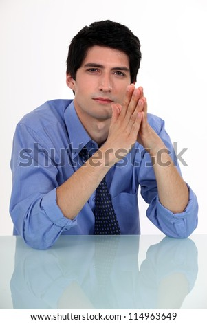 Businessman with his hands pressed together - stock photo