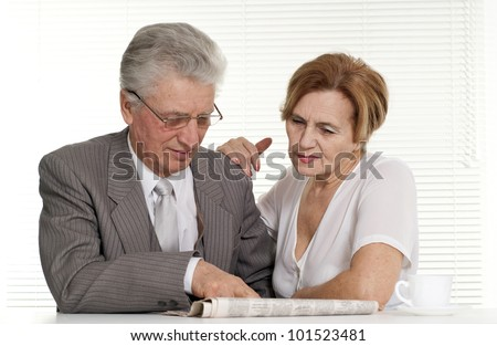 Businessman with his secretary on a light background