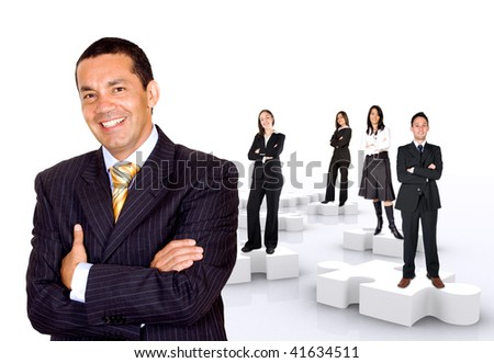 businessman with his teamwork on puzzle pieces isolated over a white background - stock photo