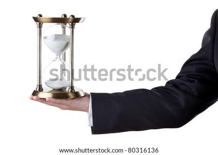 Businessman with hourglass in hand isolated on white