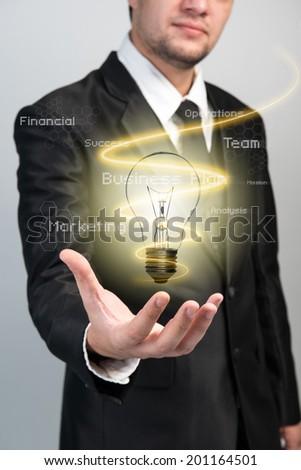 Businessman with idea light bulb - stock photo
