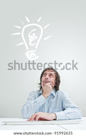 Businessman with idea, light bulb above his head