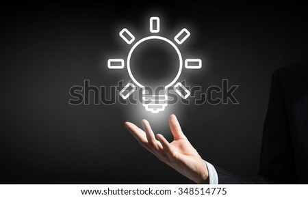Businessman with illuminated idea bulb in hand