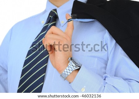 Businessman with jacket on the shoulder and shinny wristwatch isolated on white