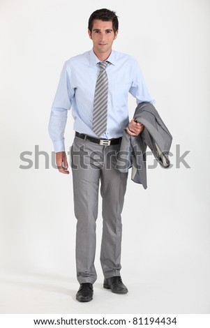 Businessman with jacket over arm - stock photo