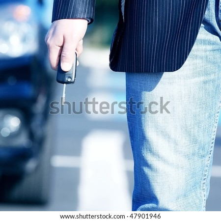 businessman with  key and car for business travel-2 - stock photo