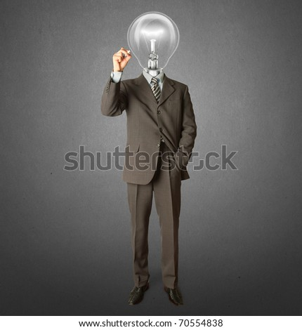 businessman with lamp-head and marker writting something on glass writeboard - stock photo