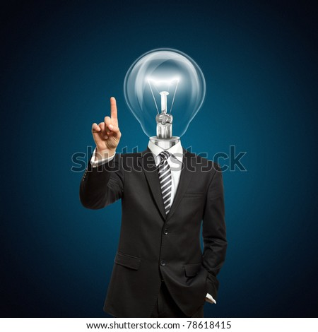 businessman with lamp-head push the button on virtual touch pad - stock photo