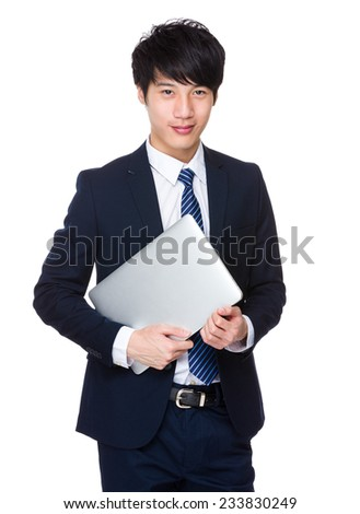 Businessman with laptop - stock photo