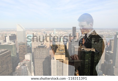 businessman with laptop and city - stock photo