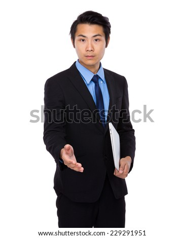 Businessman with laptop and give hand - stock photo
