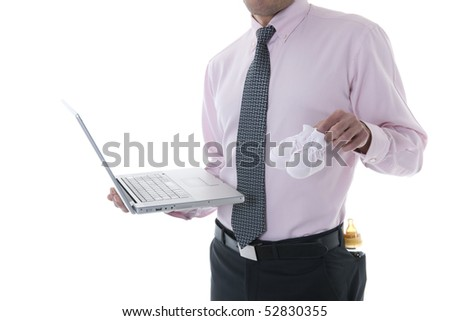 Businessman with laptop, baby shoe and milk bottle in the pocket. Concept: multi-tasking, modern man - stock photo
