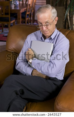 Businessman with laptop computer at home.