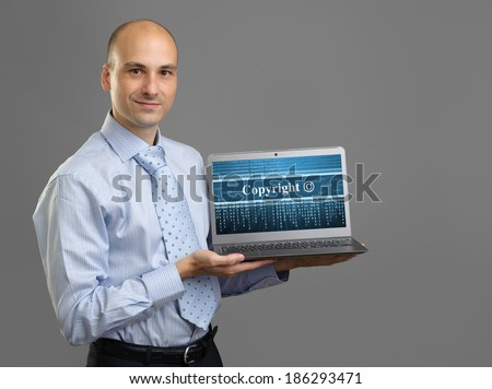 Businessman with laptop. Copyright concept - stock photo