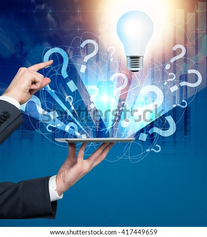 Businessman with laptop found answer to questions. Idea concept - stock photo