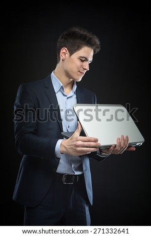 businessman with laptop in the studio