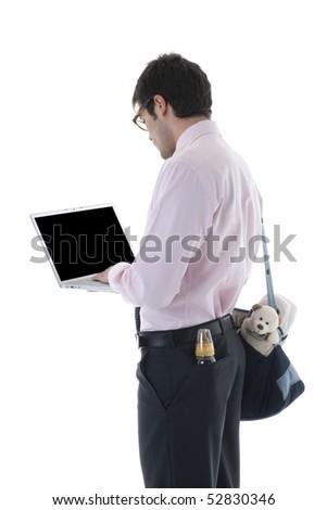 Businessman with laptop, milk bottle and diaper bag. Concept: multi-tasking, modern man - stock photo