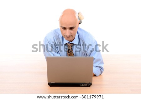 Businessman with laptop working in a wooden floor - stock photo