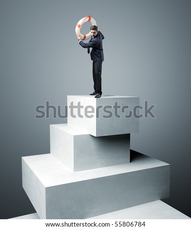 Businessman with Life Buoy Rescue on 3d virtual tower - stock photo