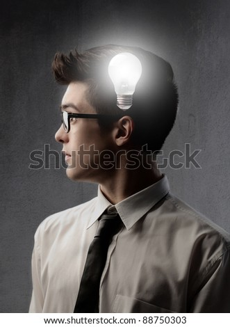 Businessman with light bulb on his head - stock photo