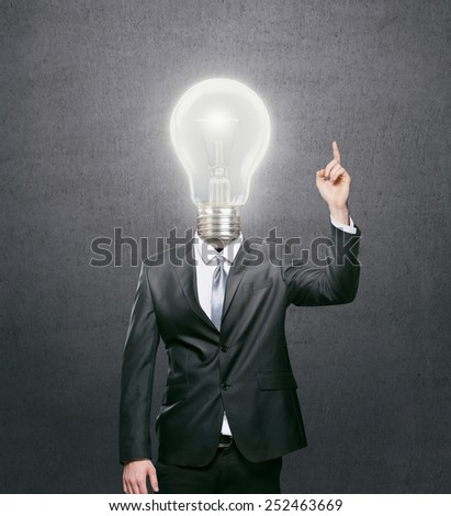 Businessman with lit light bulb as a head, idea concept - stock photo