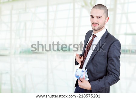 businessman with lots of money, at the office - stock photo
