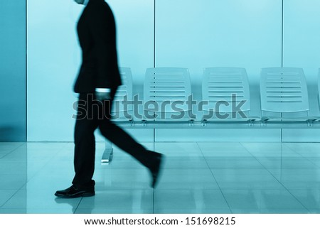 Businessman with luggage in airport