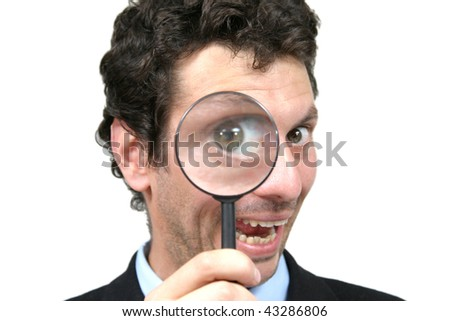 businessman with magnifying glass, isolated on white