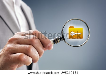 Businessman with magnifying glass over file, folder or document icon concept for security inspection, protection and confidential data - stock photo