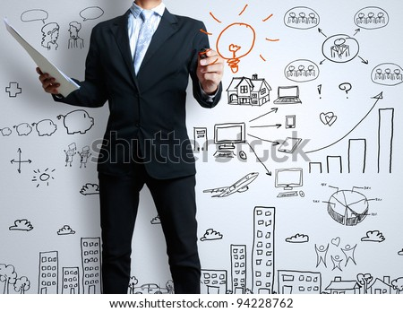 businessman with marker writing something - stock photo