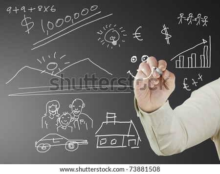 businessman with marker writing something on glass writeboard - stock photo