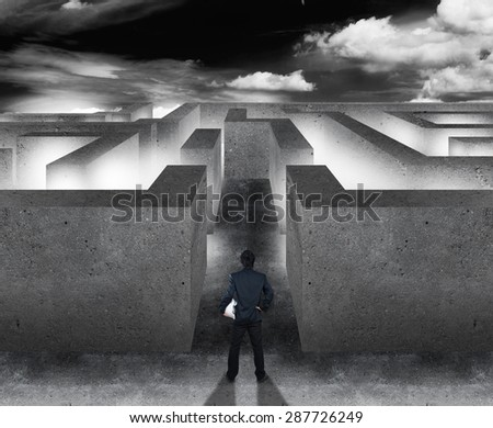 Businessman with maze, business concept of decision making - stock photo