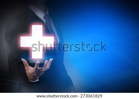 businessman with medical sign on abstract background .health,insurance