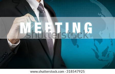 Businessman with MEETING WORD