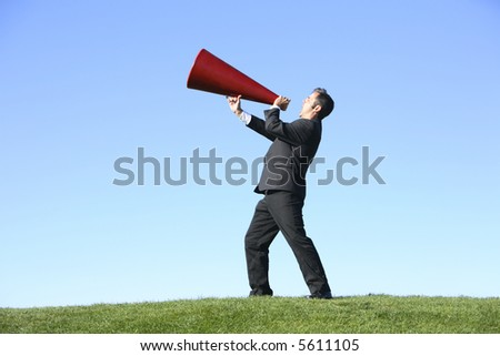 Businessman with megaphone - stock photo