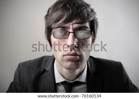 Businessman with misted glasses