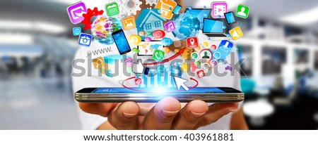 Businessman with modern mobile phone in his hand and applications icons flying over