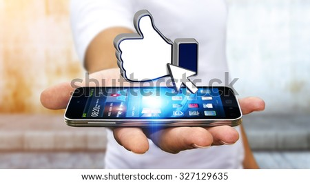 Businessman with modern mobile phone in his hand liking a social network - stock photo