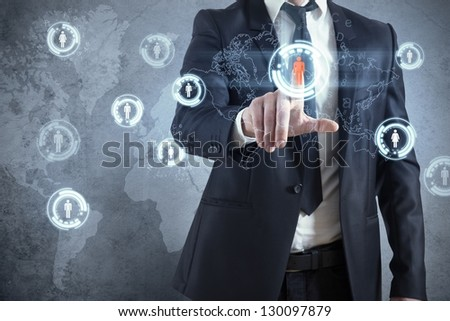Businessman with modern social network virtual interface - stock photo