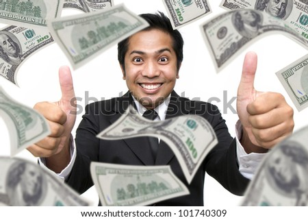 Businessman with money around isolated against a white background - stock photo
