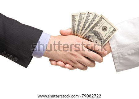 Businessman with money handshaking with doctor isolated on white background - stock photo