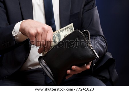 Businessman with money in hands. - stock photo