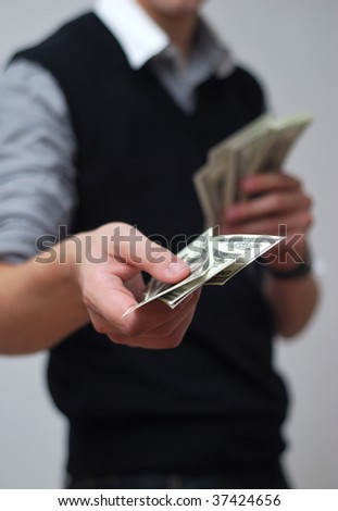 businessman with money in hands. cash payment - stock photo