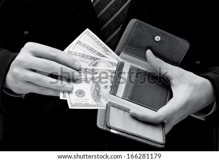 Businessman with money in his wallet