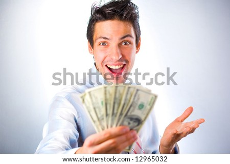 Businessman with money isolated in white background - stock photo