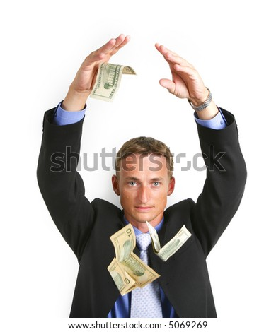 businessman with money looking at camera - stock photo