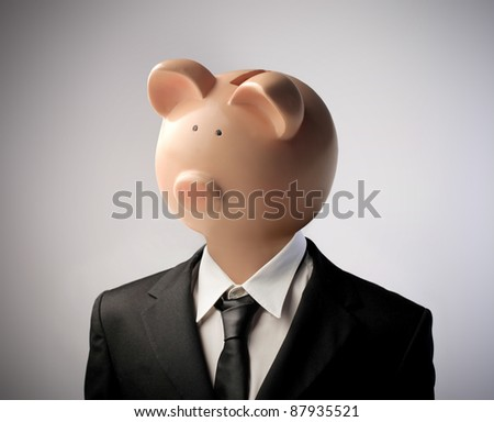 Businessman with moneybox instead of his head - stock photo