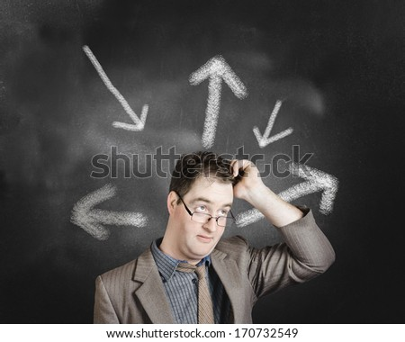 Businessman with multiple choices thinking up a direction forward on arrow chalkboard background. Career path strategy  - stock photo