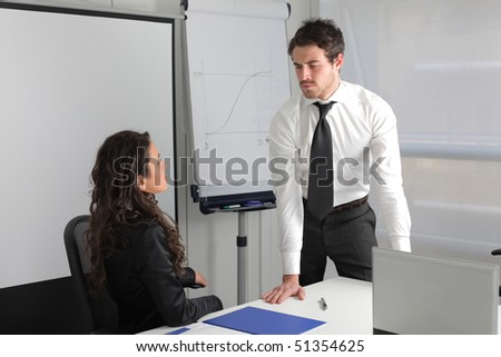 Businessman with negative expression and businesswoman sitting - stock photo
